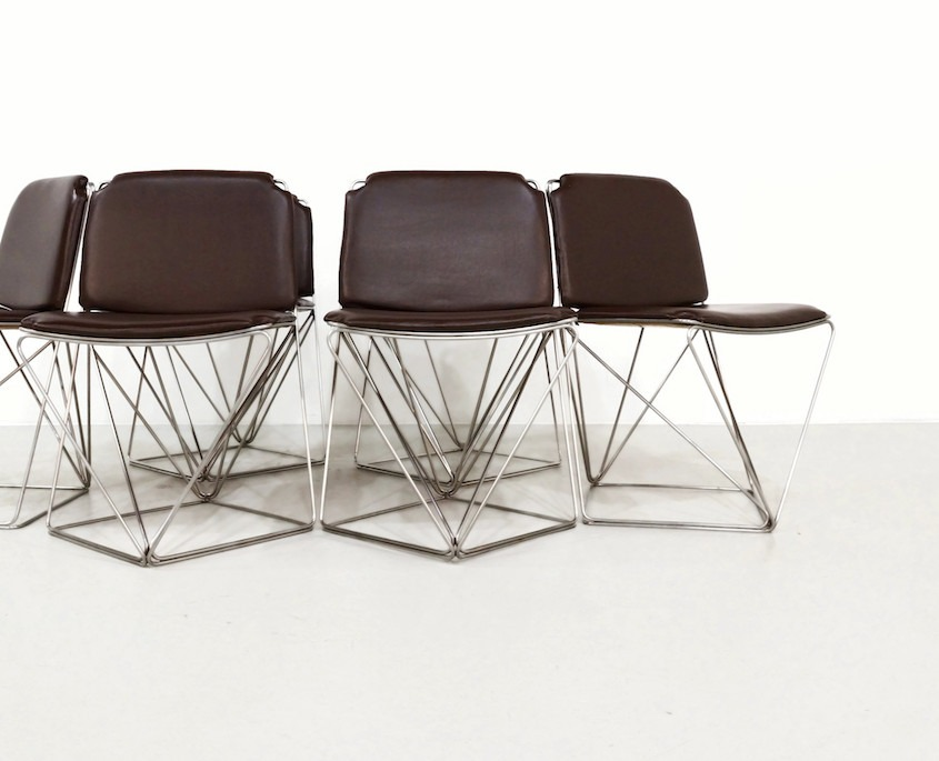 Vintage dining chairs on a metal wire bas